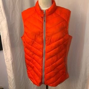 Gap puffer vest in orange. New with tags XL